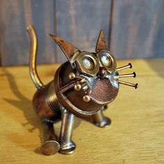 Assembled with solid brass pipe fittings, bars, nuts, & nails. This Brass Cat has been cleaned and sanded to sit well on flat surfaces. This cats head can be turned on its threaded pipe body. Salvaged Brass and copper parts soldered together.