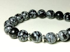 5335 SNOWFLAKE OBSIDIAN Stretchy Bracelet, Mens Unisex, Natural Grey Black Stone 10mm Wrist Mala Healing Protection Base Chakra Meditation, gift for him, birthday or holiday gift for boyfriend, dad, son, brother, colleague. Enjoy the beauty & power of natural gemstone - find SNOWFLAKE OBSIDIAN healing properties below.MATERIALS & DIMENSIONS✦✦✦✦✦✦✦✦✦✦✦✦✦✦✦✦✦✦✦✦✦✦✦ Natural SNOWFLAKE OBSIDIAN, grey-black, smooth round beads 10mm;✦ Silver Pewter TierraCast accent spacers;✦ Doubled high quality elast Stretch Bracelets, Bracelets For Men, Beaded Bracelets, Blue Gemstones, Natural Gemstones, Dad Son, Snowflake Obsidian, Chakra Meditation, Bracelet Sizes