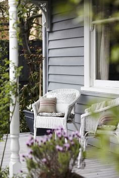 Very traditional narrow front porch but has the necessary elements to enjoy a sit down.