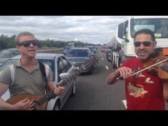 2 clips from 2/3rds of Faustus playing live in a traffic jam on the