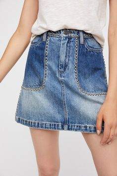 Blackbuster Mini Skirt | Soft denim high-waisted mini skirt featuring edgy metal stud trim. * A-line silhouette * 4-pocket style * Button closure and zip fly