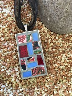 A personal favorite from my Etsy shop https://www.etsy.com/listing/523918389/red-and-blue-mosaic-pendant-necklace