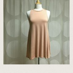 Blush Tank Dress.  Blush Tank Dress.96% polyester.   Light weight, Flowy and soft!  Drapes well!   Not sheer!   Made in USA.  Very soft and comfy...   Price is firm unless bundled.                                                                    no PP/trade.  Available in S M L in black or blush color. April Spirit Dresses
