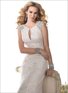 Maggie Sottero 'Ellie'  Description: This elegant lace gown plays up the glamour of old Hollywood. Jeweled shoulders, accented with Swarovski crystals and a keyhole neckline offer a fresh twist on a timeless classic. Finished with zipper back closure. Division: Haute Couture  $1489.00