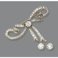 DIAMOND BOW BROOCH, CIRCA 1900 The ribbon bow with articulated ends set in the center and at the terminals with 3 old European-cut diamonds altogether weighing approximately 3.35 carats, completed by numerous smaller old European-cut diamonds weighing approximately 3.10 carats, mounted in platinum and gold.