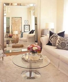 Small living Room - the huge mirror lean on the wall makes this small space look larger