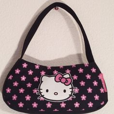 """Hello Kitty Pink Flower Hand Bag Purse Hello Kitty Pink Flower Hand Bag Purse. Measurements: Width 7.5"""". Length 3.5"""". Height 3.5"""". Handle Strap 13.5"""". Excellent Condition Hello Kitty Bags Shoulder Bags"""