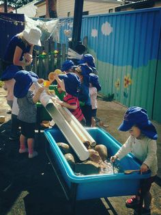 "Pipes, bamboo & rocks in the water troughs at Elder Street Early Childhood Centre ("",)"