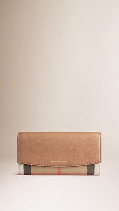 Burberry Dark Sand House Check and Leather Continental Wallet -  Continental wallet in House check with a grainy leather trim and foldover front The leather interior features:  12 card slots.  Two full-length slip pockets.  A full-length zipped coin pocket.  Two expandable compartments.  The wallet is housed in a soft pouch within a presentation box.  Discover more accessories at Burberry.com