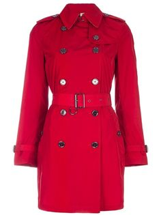 Red trench coat from Burberry Brit featuring a pointed collar, epaulettes, a top clasp fastening, a double breasted button fastening, a belted waist, blah blah.  I'd love this with piping a around