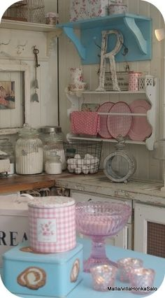 i like the initial letter, the old painted plate holder, and the old hooks upper left. be cool to hang old pans from...