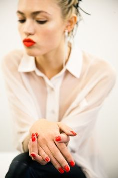 Bright red nails and lips