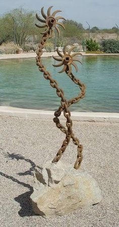 Made with chain and tiller wheels. - See this image on Photobucket.
