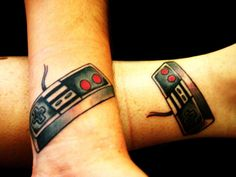 Nintendo Controller Tattoos | 26 Tattoos Your Kids Won't Understand
