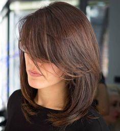 Medium Layered Haircut With Long Side Bangs
