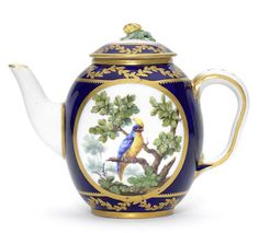 A Sèvres blue-ground teapot and cover, circa 1765. Théière 'Calabre' of the fourth size, painted by François-Joseph Aloncle with an oval bird vignette on each side, a gilt scrolling leaf border to the blue ground around the rim, the cover with flower finial and similar gilt border, interlaced LL monogram enclosing date letter M and painter's mark N in blue and incised I