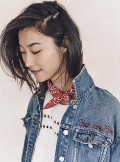 An embroidered denim jacket is worn with an eyelet top and bandana