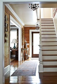 Paint the planks? The contrast is fresh, crisp. Slightly sophisticated molding vs rustic, broad, rough hewn plank walls vs clean lined modern door. Wood Plank Walls, Wood Paneling, Planked Walls, Wood Stairs, Knotty Pine Walls, Beach House Tour, Key West Vacations, Interior Paint Colors, Purple Interior