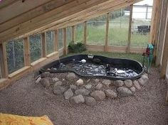 This is an ideal duck pen. Really wish we could do this. Raised duck pond then drain the water to use in the garden!