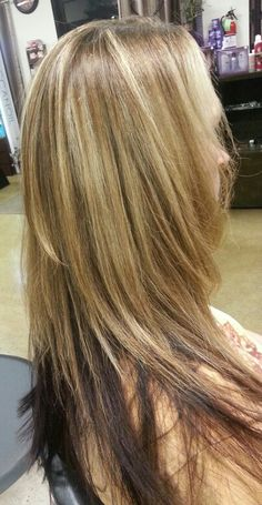 Layered long hair, highlights,  and dark red underneath