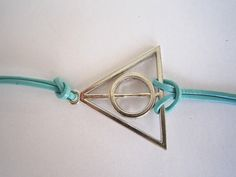 Antiqued Silver Deathly Hallows Bracelet Teal by WearingPretty, $2.99