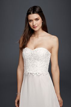 Romantic floral lace details on a corset top for a laid back wedding look. Shop this casual wedding dress style at David's Bridal