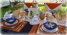 Dining Delight: Alfresco Dining in the Cabana Nautical tablescape in navy, orange and white