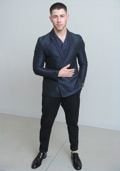 Singer Nick Jonas suits up in Emporio Armani for the brand's fall-winter 2017 show.