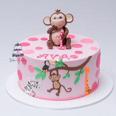 This cake is designed as a combination of Ava's party invites and a wall mural from her bedroom - lots of fun making this cheeky monkey!