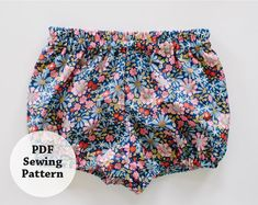 One part comfy and the other sweet -- the perfect recipe for a summer bloomer. This pattern is whips up quickly and with little yardage. Choose a variety of fabrics and patterns to build a stash of bloomers for your little one. Directions include full-color photos of entire process. Difficulty Level: Beginner This pattern available in sizes: 0-6M, 6-12M, 12-18M, 18-24M, 2T, 3T There are two downloads: the directions and the pattern pieces Share your project using #whitneydeal # baby bloo...
