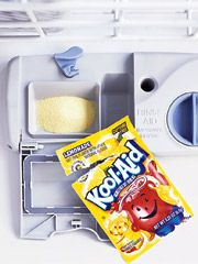 Forget fancy cleansers: Real Simple magazine says you can avoid dishwasher lime deposits and iron stains with a package of Kool-Aid:    Pour a packet of lemonade Kool-Aid (the only flavor that works) into the detergent cup and run the dishwasher while empty... The citric acid in the mix wipes out stains, so you don't have to.    Remember, lemonade only - the red stuff could be a disaster.