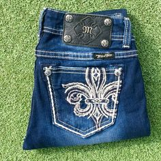 Miss Me Jeans Super skinny size 25. Jean is detailed with distressing, fading, crystal rivets, and logo hardware. Excellent condition. Miss Me Jeans Skinny