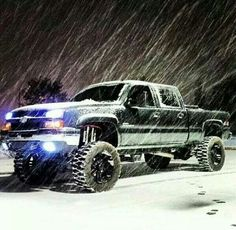 beautiful black lifted Chevy Silverado truck in Manitoba winter (proud to live here ;))