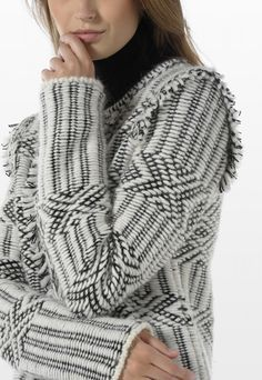 Knit blouson in mixed wool candlewick yarn with fringe motif on the front and the sleeve cuffs