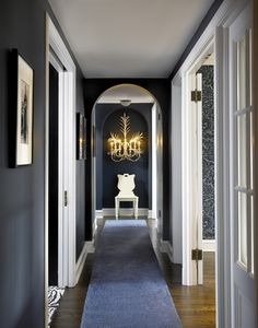 white black blue chic hallway design by melanie elston