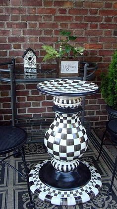 Mackenzie Childs again.  VERY COOL!   JUST AN IDEA:  why not recycle items and make an extra table for patio  (like u do for a bird feeder)  and paint those ugly metal folding chairs to match.