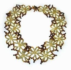 Beaded necklace: Fleur.  The use of darker beads on the outsides of the flower motifs is a great touch - makes for a much more interesting piece.