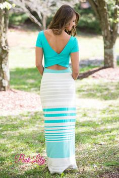 This gorgeous short sleeved maxi has so much to love! Featuring a combination of jade, taupe, and off white stripes paired with a jade bodice, the color combination is easy to rock all summer long. The back is where this dress really shines, though - it features criss cross overlapping fabric in the back creating a medium sized cutout in mid-back and a v-cutout on the upper back.