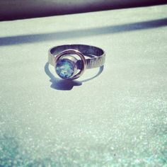 ygritte ring by #danikeithdesigns {14k gold halo, fine & sterling silver and blue topaz}