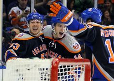 New York Islanders center Casey Cizikas (53), Thomas Hickey (14) and Colin McDonald (13) celebrate a goal by Cizikas during the second period of an NHL hockey game against the Washington Capitals at the Nassau Coliseum in Uniondale, N.Y., Saturday, March 9, 2013. (AP Photo/Paul J. Bereswill)    Read more here: http://www.charlotteobserver.com/2013/03/09/3904671/the-daily-edit-031013.html?spill=1#storylink=cpy