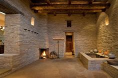 Tile lined Roman tub and corner kiva wood-burning fireplace, bathing experience