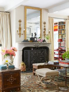 The space above a fireplace mantel is a prime decorating opportunity. For a French look, there are a few rules of thumb to follow: 1. Select a mirror that is about as wide as the fireplace and as tall as possible. Your goal should be to fill the area from the mantel to the ceiling. 2. Choose a mirror with an ornate gold frame. (Bonus points if it's antique!) 3. In front of the mirror place a bust, floral arrangement, or pair of candelabras.