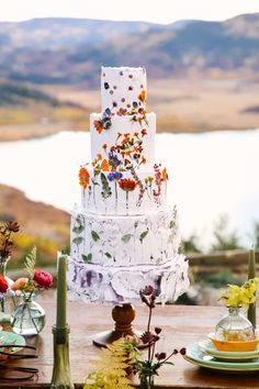 25 a textural white wedding cake was done with pressed flowers and greenery is a bold and fun idea for a summer wedding - Weddingomania Purple Wedding Cakes, Amazing Wedding Cakes, Wedding Cakes With Flowers, Elegant Wedding Cakes, Wedding Cake Designs, Creative Wedding Cakes, Flower Cakes, Elegant Cakes, Wedding Cake Toppers