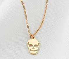 Get wild with this gold skull necklace - very chic and fashionable necklace. A 14K goldfilled thin skull charm on a dainty 14K goldfilled chain.