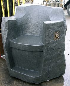 Carved stone throne from basalt column