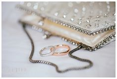Hotel Monaco DC wedding. Wedding bands and a beaded purse. Photo by Love Life Images.