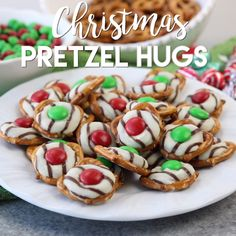 festive Christmas Pretzel Hugs are melted just enough to press an M&M on t. These festive Christmas Pretzel Hugs are melted just enough to press an M&M on t., These festive Christmas Pretzel Hugs are melted just enough to press an M&M on t. Christmas Pretzels, Christmas Party Food, Xmas Food, Christmas Appetizers, Christmas Sweets, Christmas Cooking, Christmas Gifts For Neighbors, Christmas Baking For Kids, Kids Christmas Treats