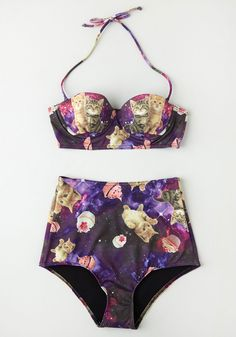 This suit has kittens and desserts floating in outer space.......... Know an Eccentric or Two Swimsuit Top. The key to a memorable day on the beach? #purple #modcloth
