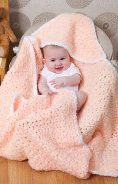Rock-a-Bye Blanket Crochet Pattern - This blanket has a cozy hood to cradle baby's head. Crocheted in super bulky yarn, it's the perfect choice when time is short and you need a baby or shower gift in a hurry.