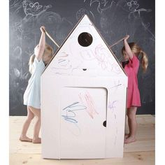 Build this cardboard playhouse out of folded pieces and decorate it yourself. It's so big, even your kids fit inside. Cardboard Playhouse, Cardboard Toys, Cardboard Furniture, Cardboard Houses, London Kids, Cardboard Fireplace, Cool Kids Rooms, Fireplace Furniture, Business For Kids